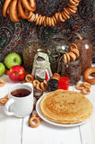 Maslenitsa festival meal. Pancake with caviar and tea. Maslenitsa festival meal. Pancake on white background stock image