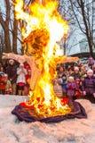 Maslenitsa (pancake week). Burning the effigy of Winter, surrounded by people. Stock Images