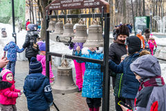 Maslenitsa (pancake week).The Children are trying to ring the bells. Stock Image