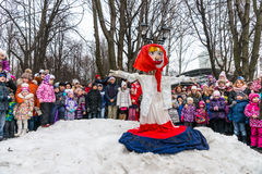 Maslenitsa (pancake week). The effigy of Winter, surrounded by people. Stock Photo