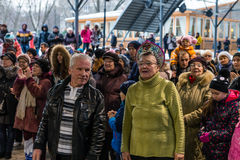 Maslenitsa (pancake week). An elderly couple watching a concert in honor of the Holiday. Stock Images