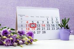Maslenitsa or Pancake week. February 12 mark on the calendar on. Purple background royalty free stock photography