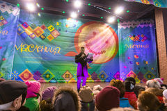 Maslenitsa (pancake week). The host announces the beginning of the competition. Winter 2015. Day. Russia. Moscow. Maslenitsa (pancake week). The host announces stock image