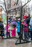 Maslenitsa (pancake week). Masterclass from the team of bell ringers Crimson Bells. The Children are trying to ring the bells. Stock Photography