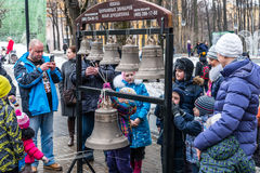 Maslenitsa (pancake week). Masterclass from the team of bell ringers Crimson Bells. The Children are trying to ring the bells. Royalty Free Stock Image