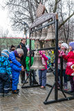 Maslenitsa (pancake week). Masterclass from the team of bell ringers Crimson Bells. The Children are trying to ring the bells. Stock Images