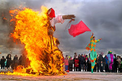 Maslenitsa. Burning Shrovetide doll to mark the arrival of spring Royalty Free Stock Photo