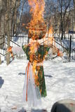 Maslenitsa Russian Doll Carnival - a symbol of winter Royalty Free Stock Images