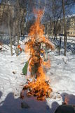 Maslenitsa Russian Doll Carnival - a symbol of winter. Maslenitsa - Russian feast to see off the winter, to meet spring. We burn the effigy of winter, because we stock image