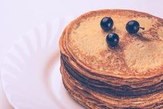 Maslenitsa 18. Vintage picture. Ukrainian pancakes on Shrove Tuesday stock image