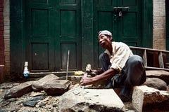Mason in Bhaktapur. Man mason at work in Bhaktapur Stock Image