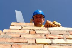 Mason with brick and trowel Stock Images