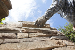 Mason or Bricklayer Setting Stone or Brick Royalty Free Stock Images