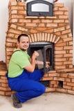 Mason building masonry heater Royalty Free Stock Photos