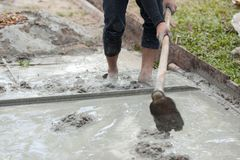 Mason building a screed coat cement at floor work. selective focus. royalty free stock photo