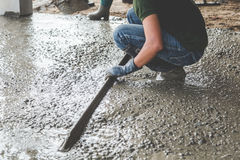 Mason building a screed coat cement Royalty Free Stock Image