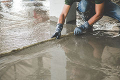 Mason building a screed coat cement Stock Images