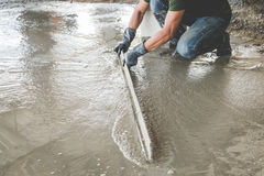 Mason building a screed coat cement Royalty Free Stock Photography