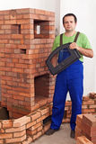 Mason building a traditional stove from bricks Royalty Free Stock Photos