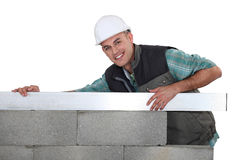 Mason building a wall. Royalty Free Stock Images