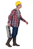 Mason carrying breeze block Stock Photo