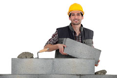 Mason carrying bricks Royalty Free Stock Image