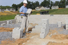 Mason with Concrete Block Stock Photos