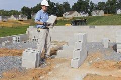 Mason with Concrete Block Stock Photos