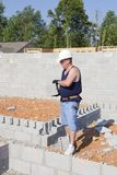 Mason with Concrete Block Royalty Free Stock Photo