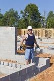 Mason with Concrete Block Stock Image