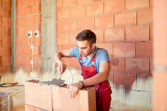 Mason construction worker building brick walls, contractor renovating house. Construction industry details Royalty Free Stock Photo
