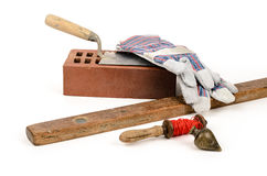 Mason equipment. Old construction accessories trowel, bricks, plummet and level on white background Royalty Free Stock Photo