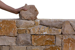 Mason hands working on masonry stone wall Stock Photos