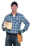 Mason holding two bricks Royalty Free Stock Images
