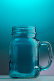 Mason jar beer glass. With handle on a light blue background Stock Photos