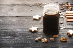 Mason jar with coffee and cookies Royalty Free Stock Images