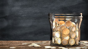 Mason jar full of coins. Financial saving metaphor. Stock Images