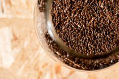 Mason jar full of seeds, healthy raw food on a table, flax seeds Stock Photo