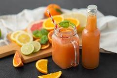 Mason jar glass of fruit juice on slate table top stock images
