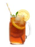 Mason jar glass of iced tea with straw isolated on white. Mason jar glass of iced tea with straw isolated on a white background Stock Photography