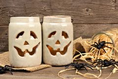 Mason jar Jack o Lanterns with spiders Royalty Free Stock Image