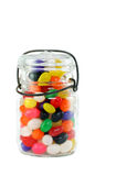 Mason Jar of Jelly Beans on White Stock Images
