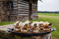 Mason Jar Pumpkin Pie. Prepared for a fall outdoor dinner party in front of a rustic log cabin Royalty Free Stock Images
