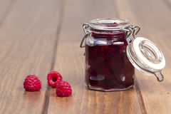 A mason jar with raspberry jam Royalty Free Stock Photo