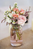 Mason jar of roses. Table decoration for wedding Stock Images