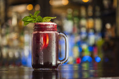 Mason jar of strawberry lemonade. With leaf of mint Royalty Free Stock Photo