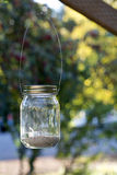 Mason Jar on wood beam Royalty Free Stock Image