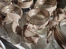 Mason Jars With Burlap Bows Lizenzfreie Stockfotografie