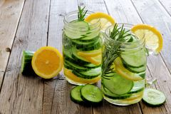 Mason jars of detox water with lemon, cucumber on wood Royalty Free Stock Photography