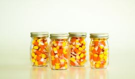 Mason jars filled with candy corn Stock Photography